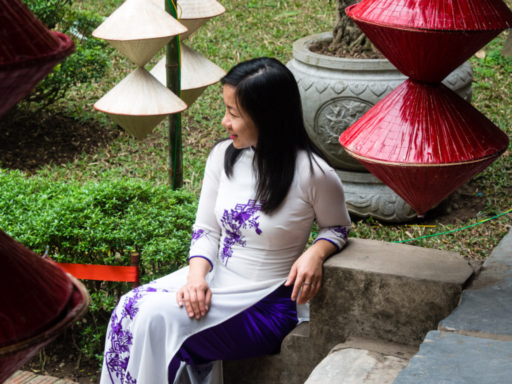 Vietnamese woman in traditional clothes at the Temple of Literature in Hanoi