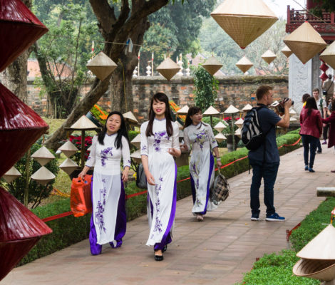 Vietnamese women in national clothes at the Temple of Literature in Hanoi
